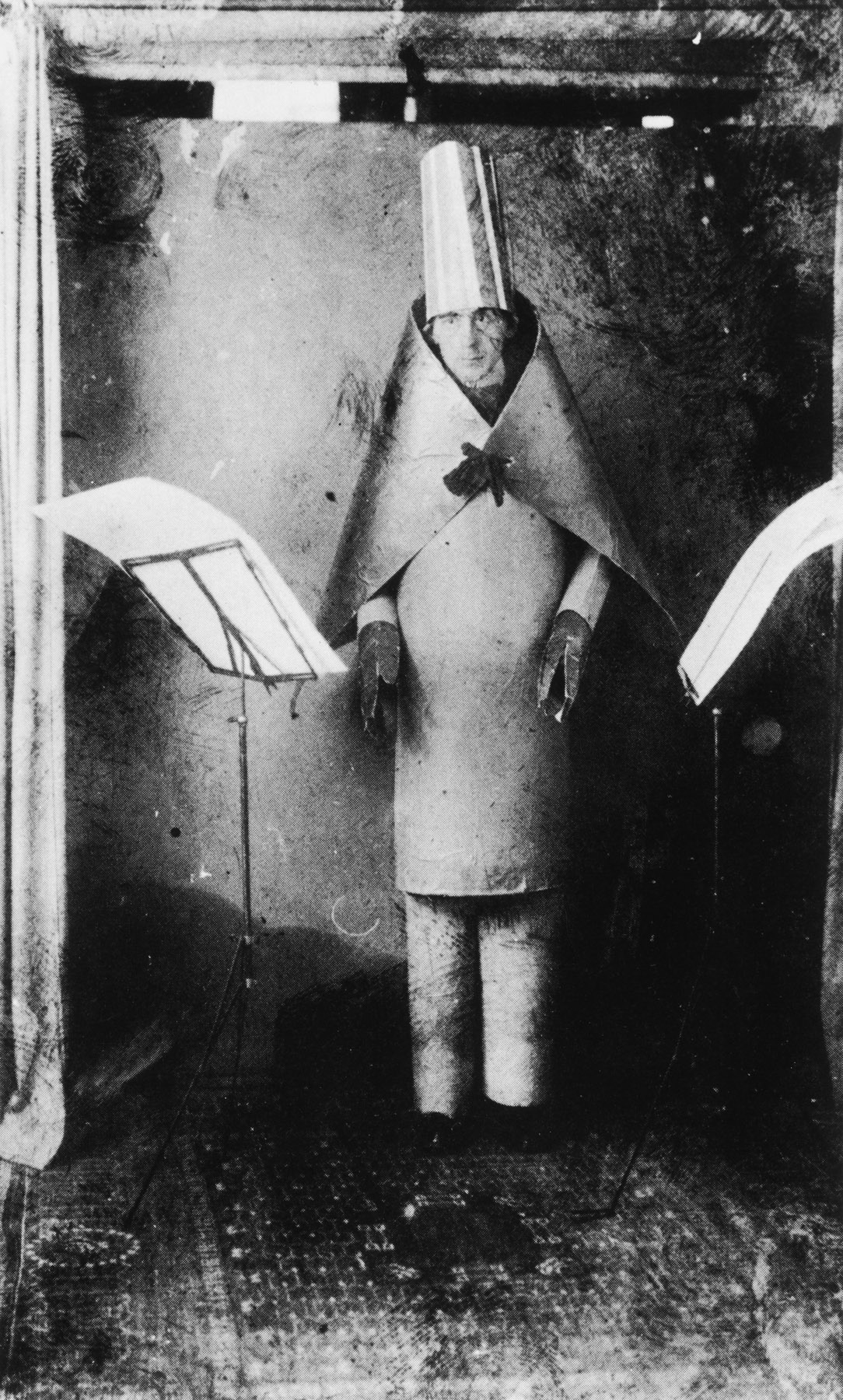 Hugo Ball in Cubist costume during Verse without Words, 1916